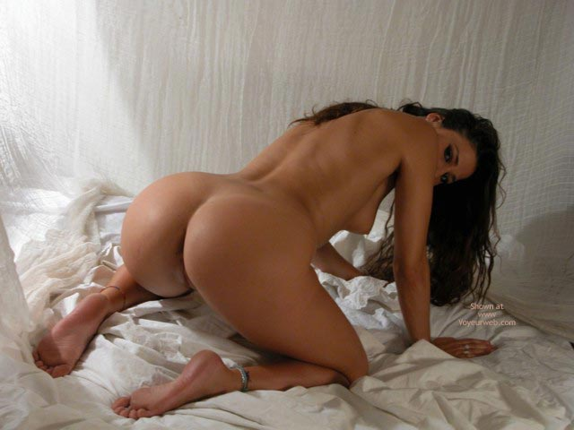 doggy style, open ass, hanging boobs, rear view of naked brunette on ...