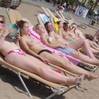 7 topless girls on beach