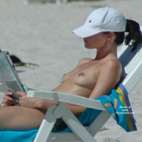 Topless Girl Reading On Beach - Brunette Hair, Natural Tits, Small Tits, Topless Beach, Topless, Beach Tits, Beach Voyeur, Naked Girl, Nude Amateur