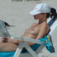 Topless Girl Reading On Beach - Brunette Hair, Natural Tits, Small Tits, Topless Beach, Topless, Beach Tits, Beach Voyeur, Naked Girl, Nude Amateur